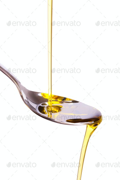 olive oil poured into spoon