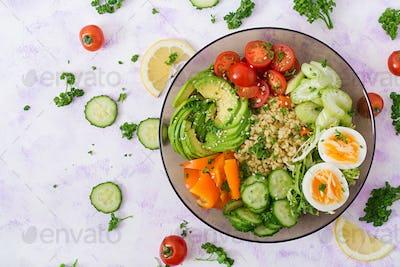 Bulgur porridge, egg and fresh vegetables - tomatoes, cucumber, celery and avocado