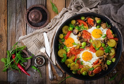 Breakfast for two. Fried eggs with vegetables - shakshuka