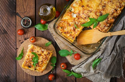 Classic Lasagna with bolognese sauce. Flat lay. Top view