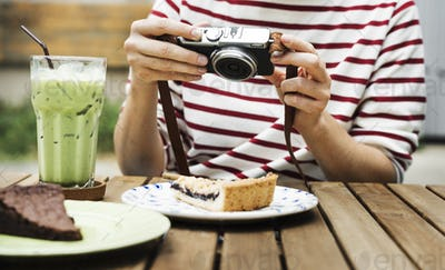 Woman holiday lifestyle taking photo cake dessert