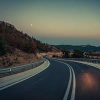 Serpentine road at night.
