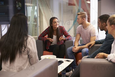 Group Of University Students Discussing Project Together