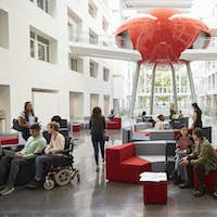 Students socialising in the modern lobby of their university