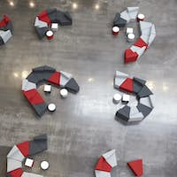 Seating in the atrium of modern university building, aerial
