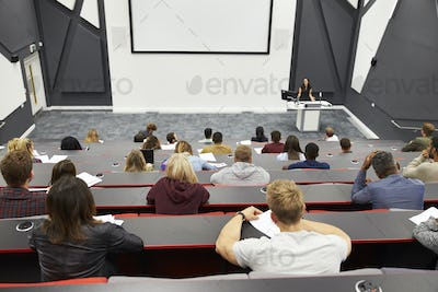 Lecture at university lecture theatre, audience POV
