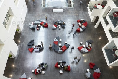 Overhead view of seating in a university atrium, motion blur
