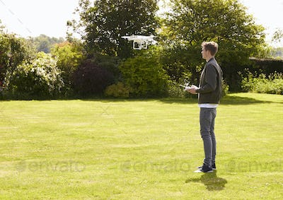 Man Flying Drone Quadcopter In Garden