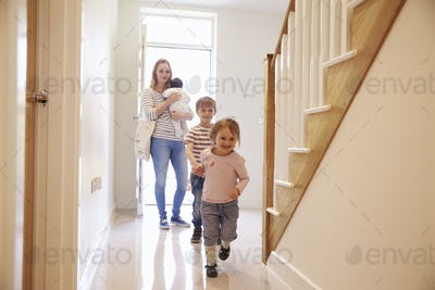 Young Family Looking Around Property For Sale
