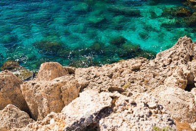 Rock cliffs and sea bay with azure water near Protaras, Cyprus island.