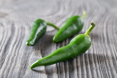 Green hot pepper on a wooden table