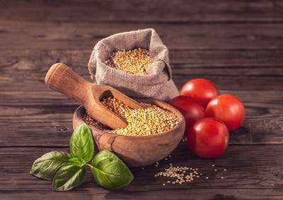 Uncooked quinoa with tomatoes and basil