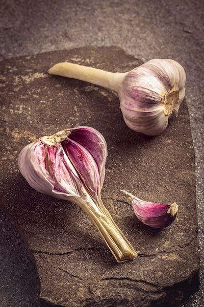Garlic on stone background