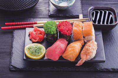 Japanese  sushi set on black tableware