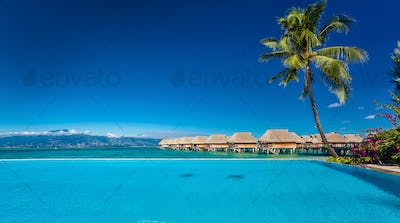 Resort with infinity swimming pool and the beach, Moorea Island,