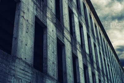 Unfinished abandoned concrete building facade