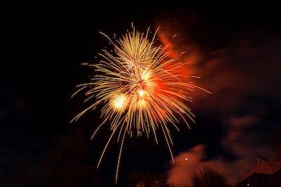 Fireworks light up close-up against dark sky