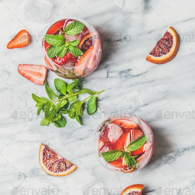 Orange and strawberry summer Sangria in glasses, square crop