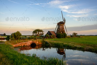 Windmill in a countryside landscape in Holland