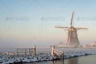Windmill in a winter landscape