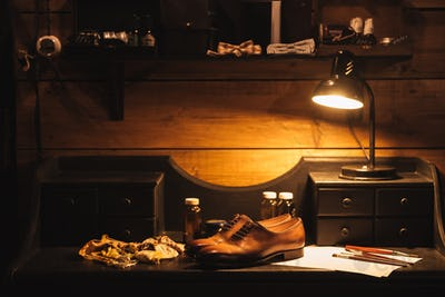 Shoes on table at footwear workshop.