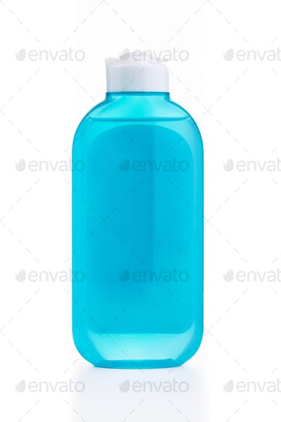 The blue plastic bottle with blue empty label isolated on white