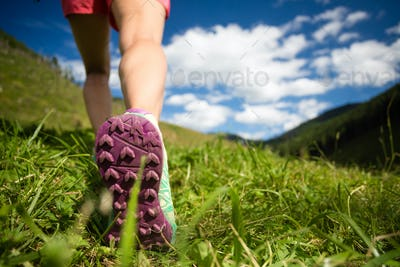 Woman hiking in mountains, adventure and travel