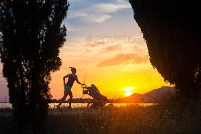 Silhouette of running mother with stroller enjoying motherhood a