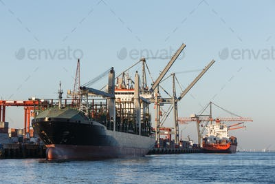Cargo ships in port being loaded