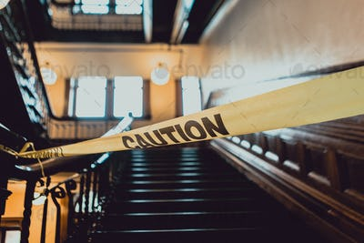 Caution Tape in Front of Stairs