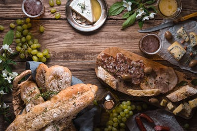 Assortment of appetizers on the wooden background horizontal