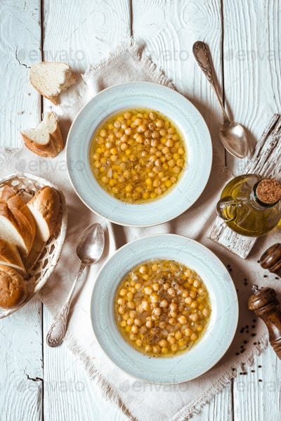 Greek chickpea soup in the white wooden table top view