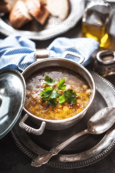 Greek chickpea soup in the pot on the stone background horizontal