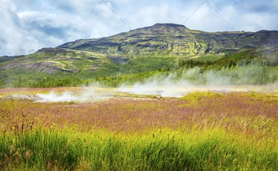 Colorful volcanic geyser landscape at Haukadalur geothermal area in Iceland