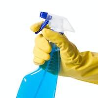 hand in glove with spray bottle