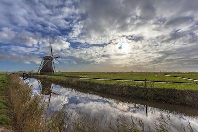 Dutch windmill overseeing polder