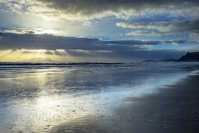 Sun Harp Through Clouds during Sunset over Hauraki Coast