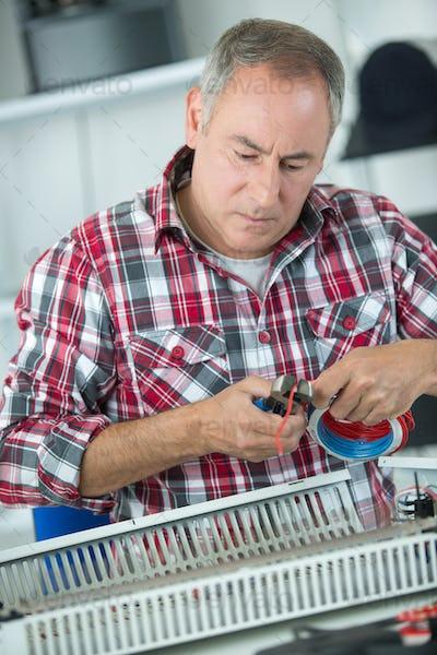man fixing radiator