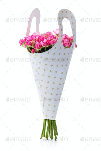 Bunch of pink roses in paper packaging