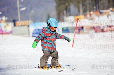 Little boy skiing downhill