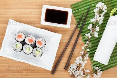 Sushi maki set with fresh sakura branch