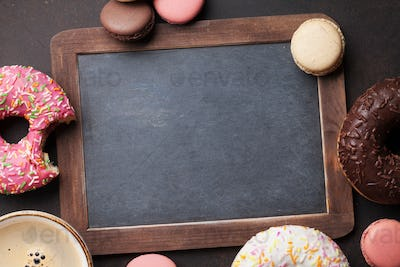 Chalkboard, coffee cup and colorful donuts