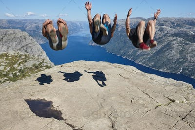 Jumpers on Preikestolen rock. Norway landmark. Astonishing photo. Lysefjorden