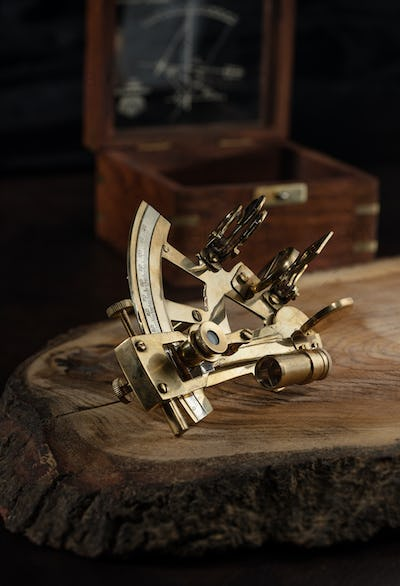 vintage still life with sextant