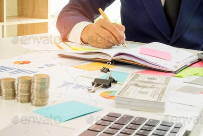 Business finance concept,Business people are analyzing the work and taking notes.