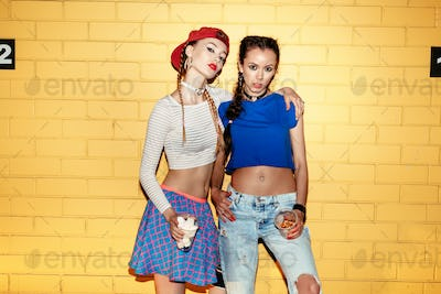 Two models in summer casual clothes
