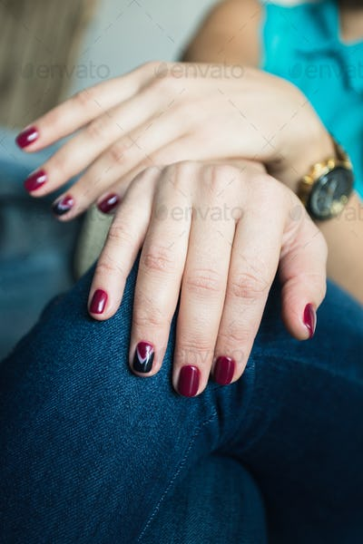 Beautiful woman's nails with beautiful red manicure