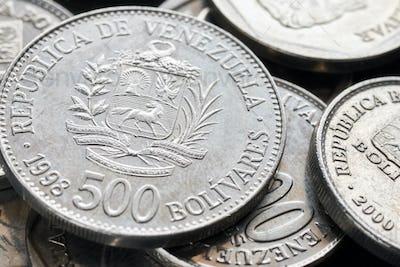 Extreme close up picture of old Venezuelan bolivar coins.
