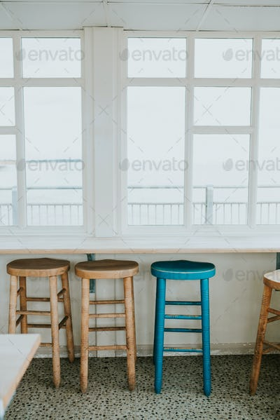 Wooden chairs by the window