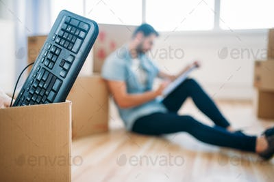 Box with keyboard, moving to new house concept
